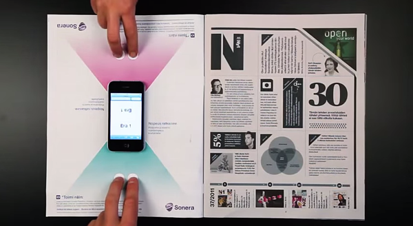 Interactive print ad by Sonera featuring smartphone board game.