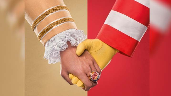 The Burger King King and Ronald McDonald hold hands in solidarity for the Day Without a Big Mac Campaign